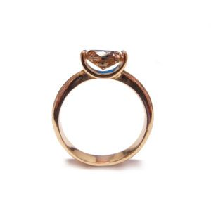 engagement ring design using a cognac diamond two claw setting in gold