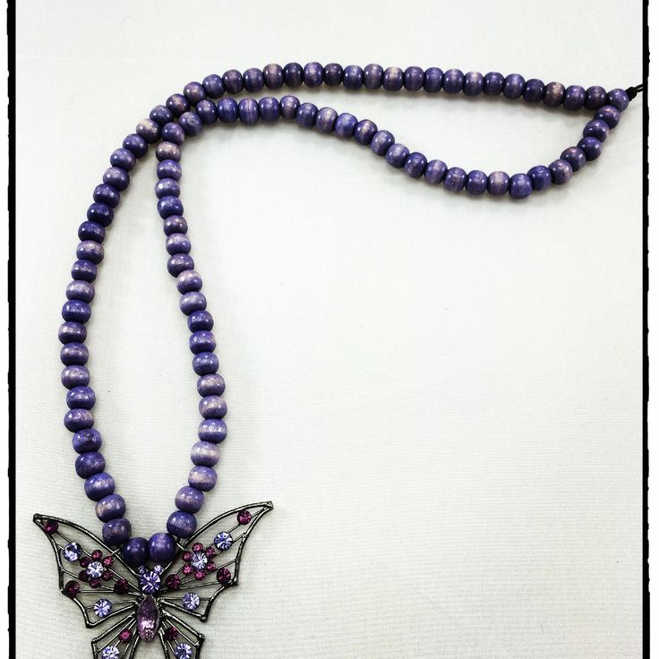 Butterfly.... Butterfly fly away home.... Soft lilac wood bead long necklace with vintage bling butterfly pendant.