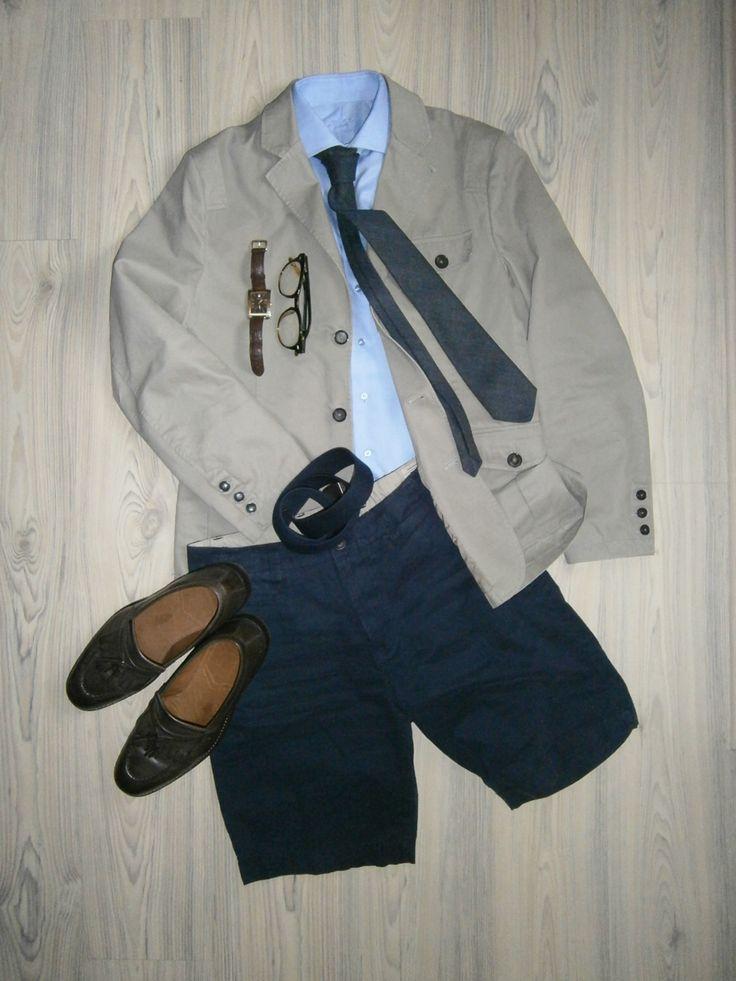 putty color three button jacket / navy blue shorts / light blue long arm shirt / structured blue tie / dark brown loafers / dark brown leather belt, angular watches