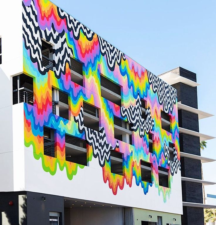 emblazoned across the flagship location of platform — a retail venue in culver city, california — is 'technicolor ooze', a drippy and trippy mural by los angeles-based artist jen stark. #designboom #jenstark