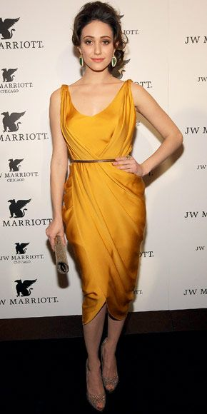 Rossum accented an amber Amanda Wakeley dress with gold accessories including Coomi jewels, Rene Caovilla heels and a Jimmy Choo bag at the JW Marriott Chicagos grand opening.