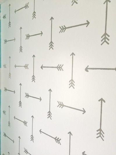 A DIY stenciled accent wall in a rustic boys room using the Tribal Arrows Allover Stencil. http://www.cuttingedgestencils.com/tribal-arrow-pattern-stencils-wall-decor.html