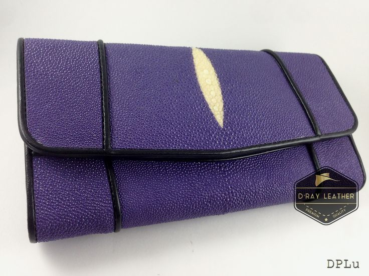 A stingray wallet for woman by @drayleather   Purple Color . These stingray wallets have a pebbly texture with a highlighted central diamond.  . A beautifully handmade example of a sting ray wallet with a full cow skin interior. . • Hand selected stingray skin direct from the tannery. • Hand cut leather • A grade cowskin interior • 19cm x 10cm • card holders • ID holders • compartments • Bill divider • Fine stitched edge . Delivery Worldwide   Free Shipping 100% Brand ..