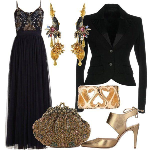 superior quality be432 a531c Un abito lungo, elegante, nero, con corpetto lavorato e ...