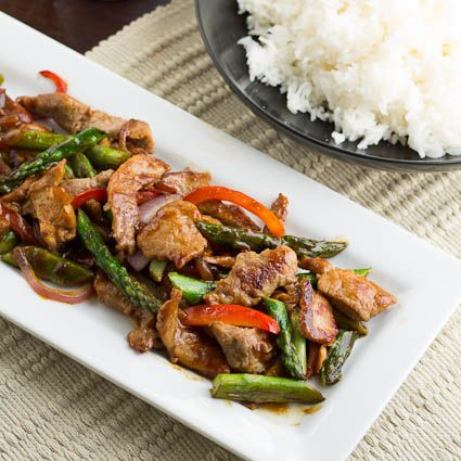 Pork and Asparagus Stir-Fry- minus the rice and some tweaking this could be made {Paleo}