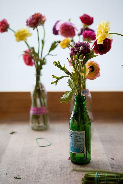 Use empty San Pellegrino bottles as vases :)