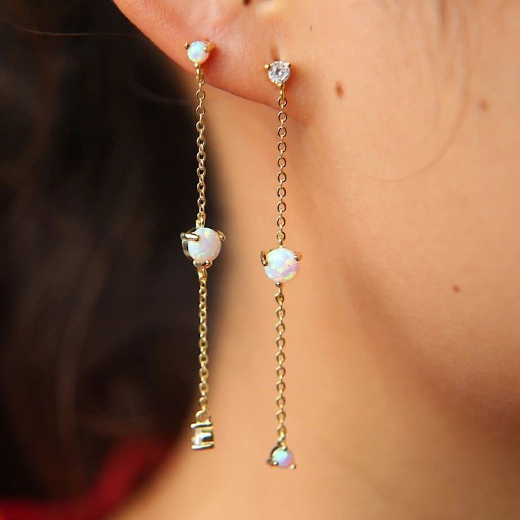 Long chain opal drop earrings with cubic zirconia that sparkle and dangle on the ear. This delicate pair of opal... #chainearrings #opalearrings