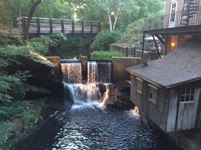 This romantic tavern overlooks a waterfall!