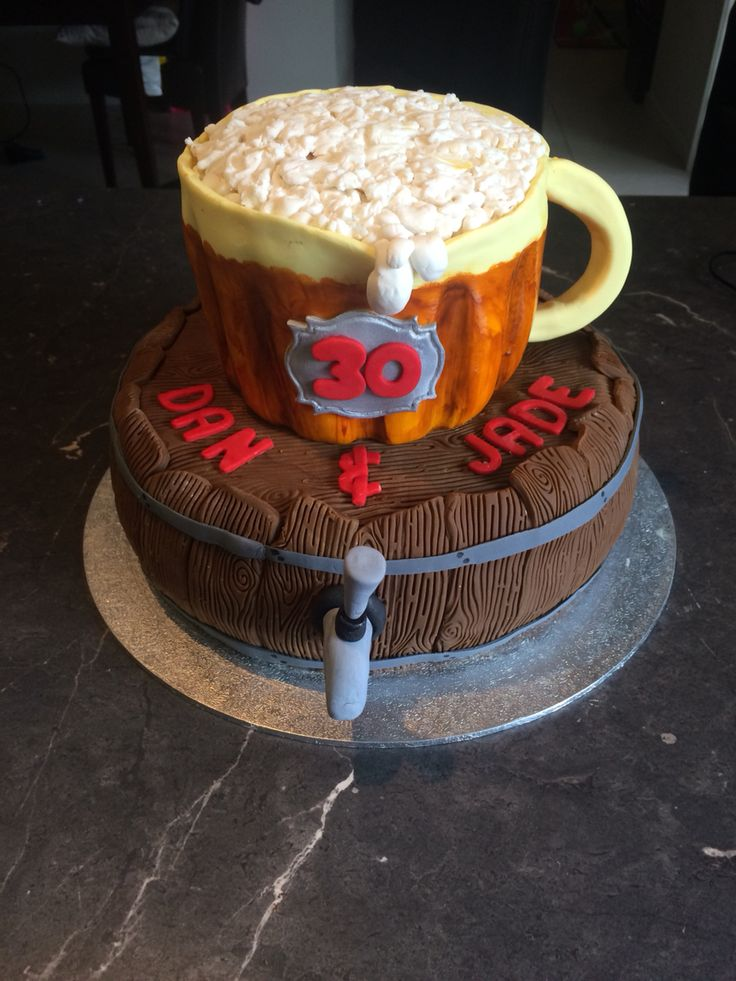 Joint 30th Birthday Celebrations! White chocolate mud barrel style cake with a chocolate mud cake on top in shape of a beer mug!!! #30th #chocolatemud #boyscake #delicious