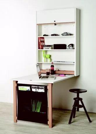 Seinälle asennettava Klaffi-kaappi avautuu ruokapöydäksi tai työtilaksi tarvittaessa.