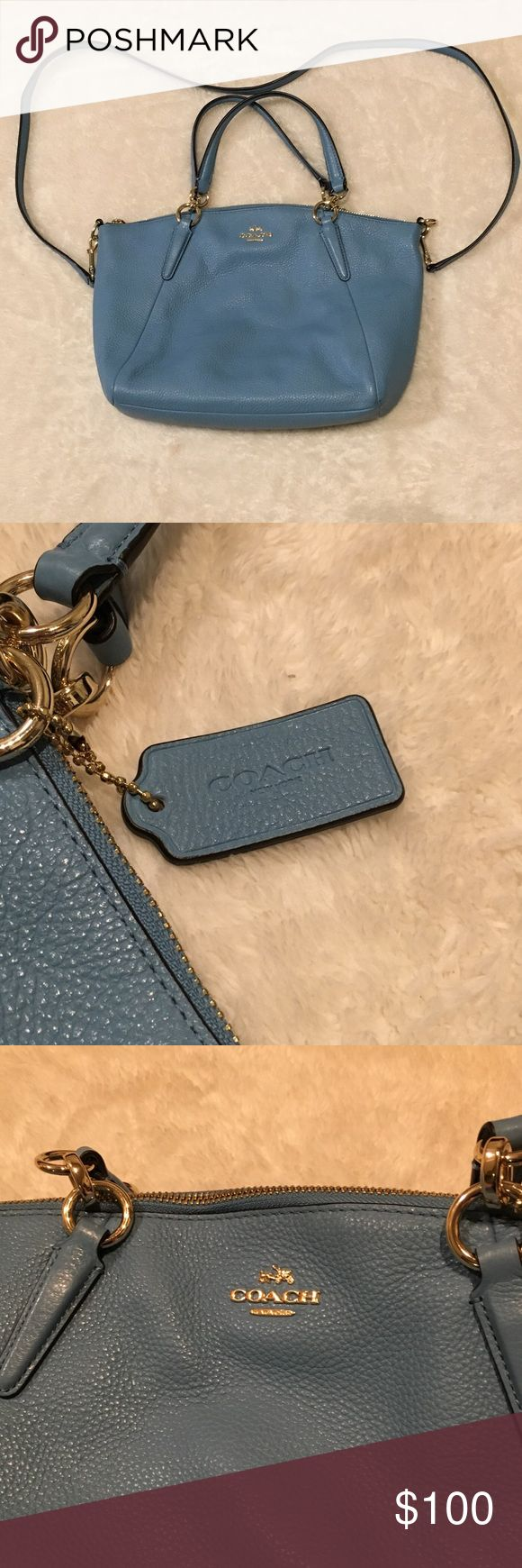 Blue leather Coach Purse Baby blue leather coach purse. Used only a handful of times. Pebbled blue leather makes this purse a soft fashion statement with any outfit in any season. Practically new and ready to ship Coach Bags