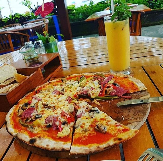 WEBSTA @ ayodyabali - A slice or more of this for your happiness. #guiltypleasure #pizza #lagoonarestaurant #epicure 📷: @sveta504