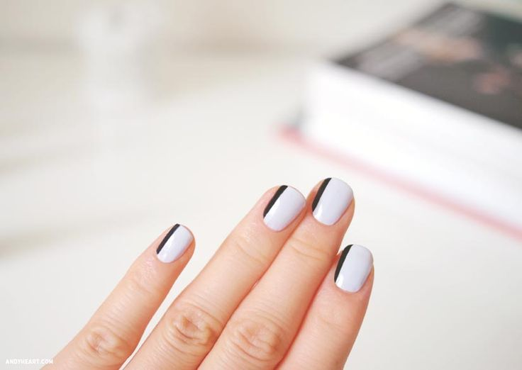 white nails with a black thin stripe