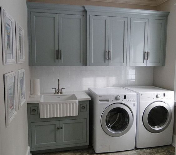 Laundry Room.  Colored Cabinets.  Mudroom Farmhouse Sink.  White Subway Tile Backsplash.  White Front Load Washer and Dryer.