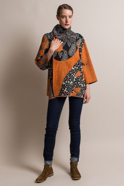$710.00 | Mieko Mintz 5-Layer Vintage Cotton Flare Jacket in Orange/Black | Mieko Mintz creates clothing from vintage saris, which are upcycled into new fashion. The reversible clothing is an artful multi-pattern combination of by Mieko that is then made into kantha fabric. Sold online and in-store at Santa Fe Dry Goods in Santa Fe, New Mexico.