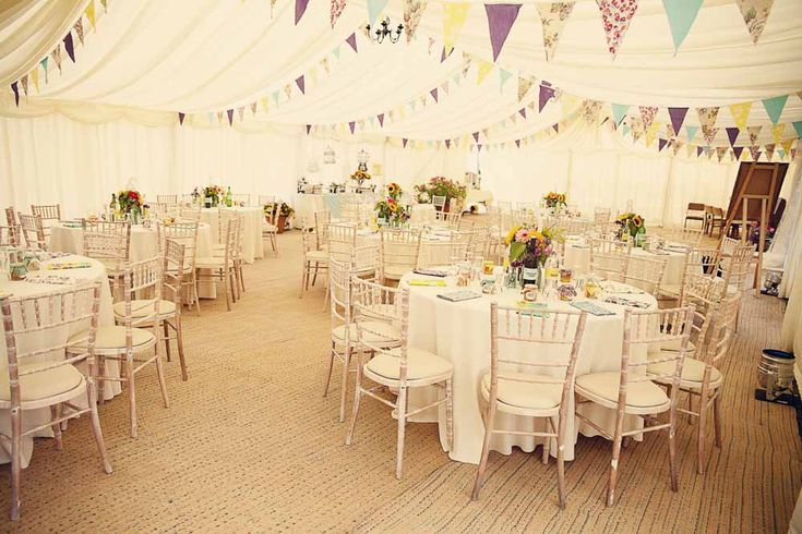 Tented wedding reception with soft-colored bunting.