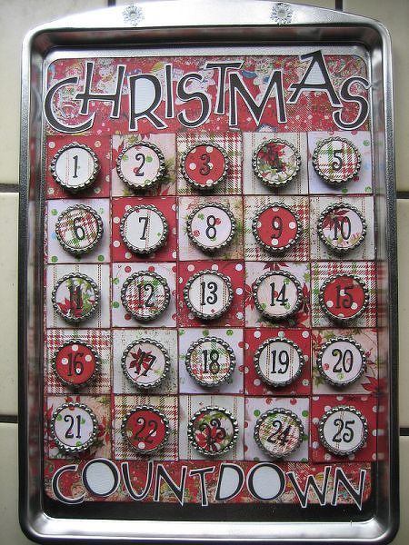 Another project...Advent calendar made out of a cookie sheet and flattened bottlecaps,,,