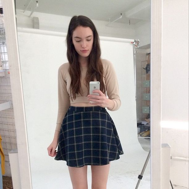 American Apparel model Megan snaps an #AASelfie in the Plaid Circle Skirt and Ponte Crop Raglan Sweater.
