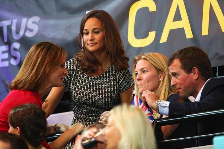 Pippa Middleton, Autumn Phillips and Peter Phillips attend the Jaguar Land Rover Exhibition Wheelchair Rugby Match during day 2 of the Invictus Games, presented by Jaguar Land Rover at the Copper Box Arena on September 12, 2014 in London, England.