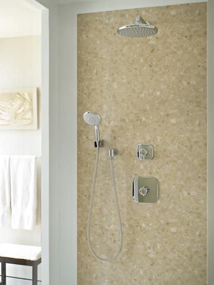 A hand-held shower is a necessity for those with physical limitations. But the fixture needs to be placed low enough to reach your feet when you sit on the shower bench. This hand-held shower is mounted lower, giving it full range. Image courtesy of Toto