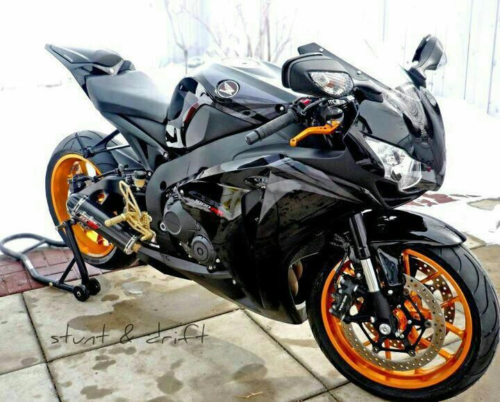 HONDA CBR 1000 RR Black and Orange ..... Time to get my black leather back out and on!