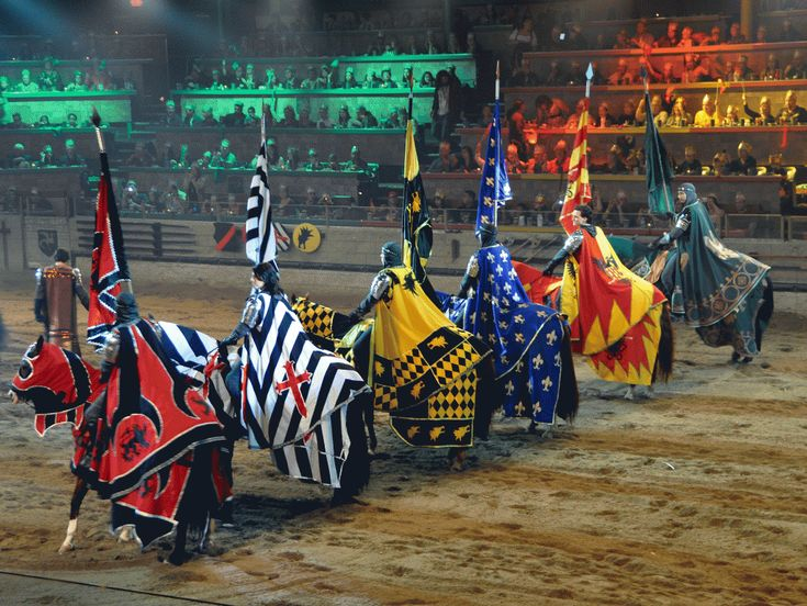 Live jousting, sword fights, horsemanship, and falconry comprise the show where guests are taking back to Medieval Times.  Guests are still divided into teams according to color and rallied to cheer for one of the six Knights of the Realm.