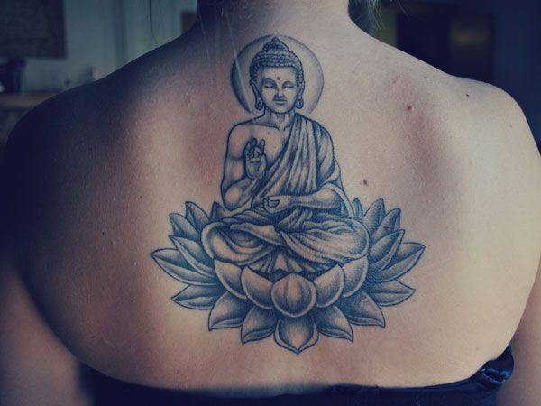 Back design of Buddha coming out of a lotus flower - Their are a ton of different Buddha meditating tattoos.