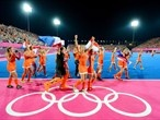 The Netherlands women's hockey team celebrate their gold medal victory