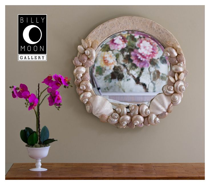 Shell Encrusted Mirror. Woven rattan mirror structure with a paper mache covering. Assorted shell natural shells. Beveled mirror. M0020