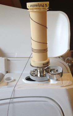 Transferring serger thread to regular sized spool for use in sewing machines! > I knew there was a way to do this! The way I used to do it didn't work on the new machine but I know this will! > I'll just use a bit of double-sided tape though as my bobbins are clear plastic.