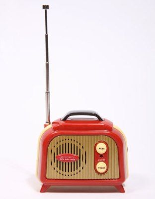 In these days of digital and internet radios, this Red Retro Radio is old-fashioned in just being an FM radio as much as for its vintage shape.