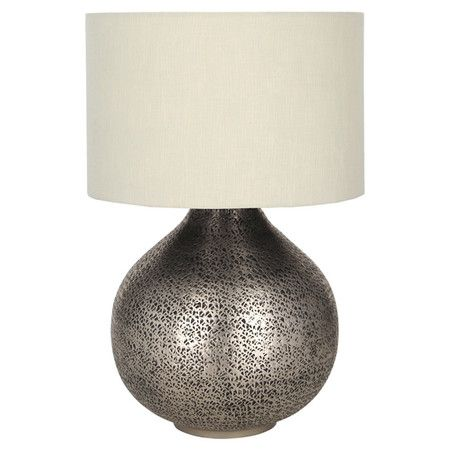 Imbue your home with eclectic appeal with this metal lamp base. With its bold silhouette and silver finish, it complements dark wood furniture and neutral de...