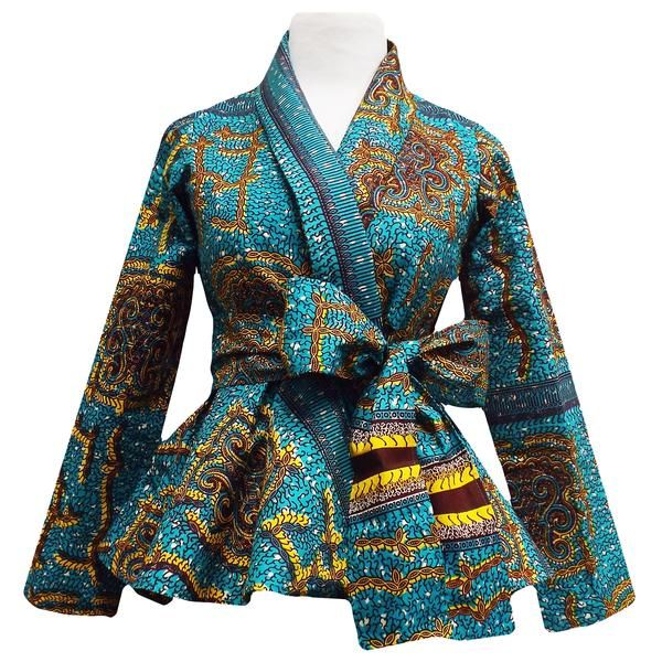 Style #2005TY Stand out in our beautiful Diola African print blazer. This African print blazer features a teal and yellow African print, with a slimming peplum style fit. Pair this blazer perfectly wi