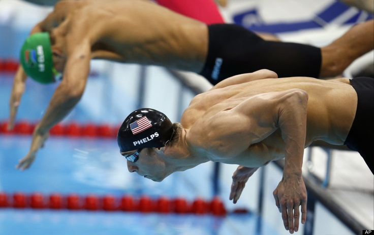 USA swimmer Michael Phelps and South Africa's swimmer Chad le Clos take the start in the 100-meter butterfly swimming final at the Aquatics Centre in the London 2012 Olympics on August 3rd. (Huffington Post)