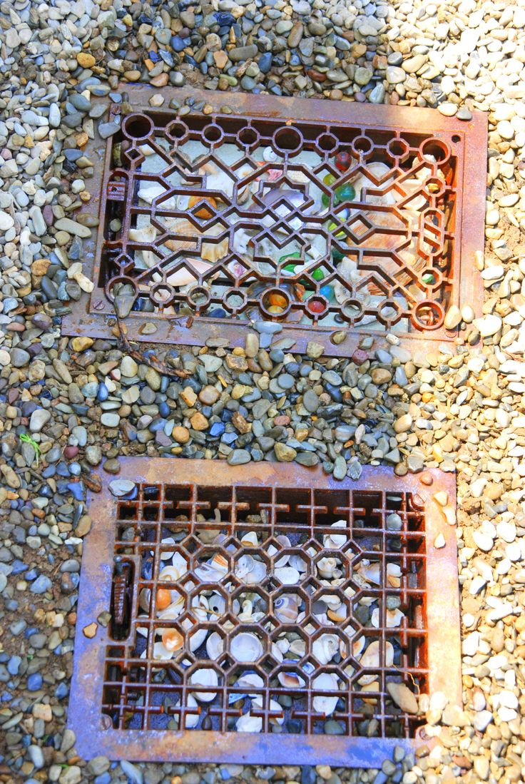 stepping stones made out of heater vents with marbles or sea glass underneath