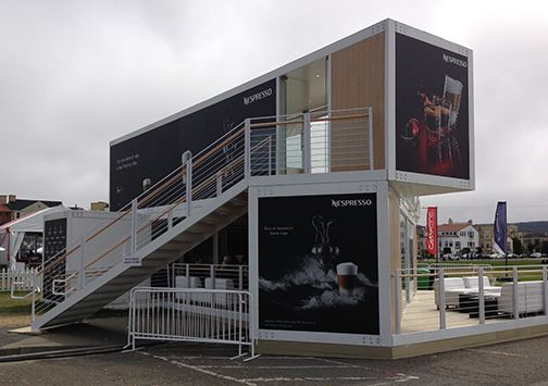 Two uses of shipping containers being used as retail buildings, one on a narrow lot on a busy street and one as a temporary shop near the site of the America's Cup race. The Nespresso shop pr…