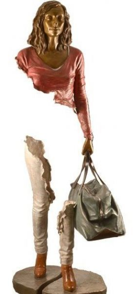 """Emilie - from a series of sculptures by Bruno Catalano called """"Travellers"""" - perhaps some vital organs have been left elsewhere (at home?) and space left for her new environment to be incorporated within her."""