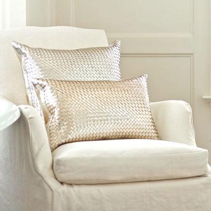 ...Metallic throw pillows add sparkle to this neutral interior.