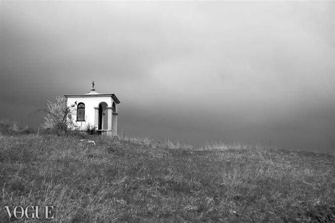 Dark clouds over Chapel by Jure Klen