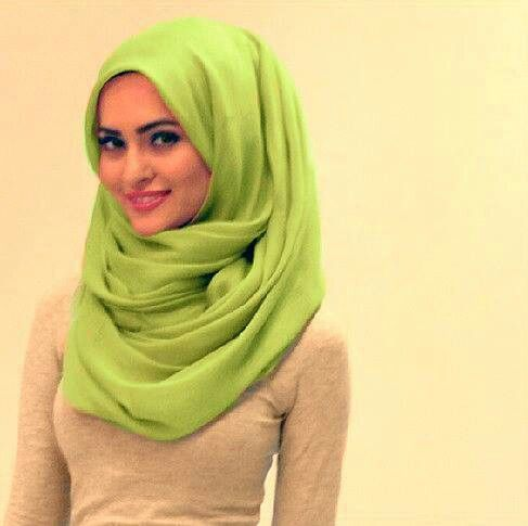 Khaleeji Hijab style:  I like how its loose w a lil volume but dont like the color the girl is pretty tho