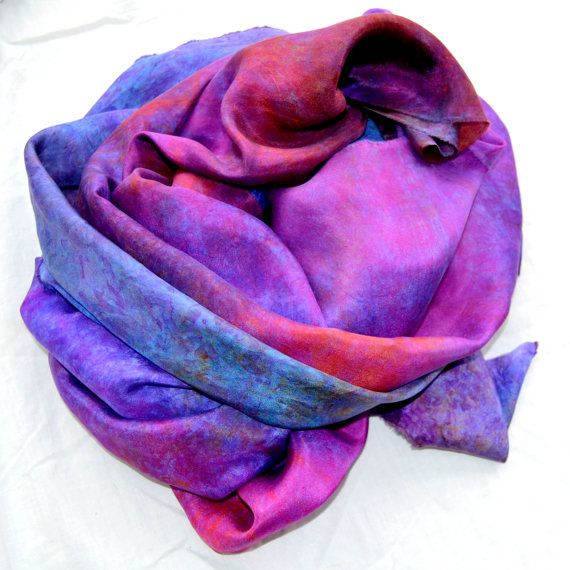 Make your own with this hand dyed 8 mm Habotai Silk Fabric. This piece is in a lovely mix of purple, turquoisy blue, pinks and peach. It measures 82 inches x 27 inches (208 x 68 cms ) and is not hemmed. It is a fine soft silk that can be used as a scarf for day wear or a wrap to take you out in the evening . Silk is surprisingly easy to care for. It is a hand dyed product so hand wash separately in cool water with a gentle detergent. Hand wring and line dry in shade. Simply warm to hot iron…