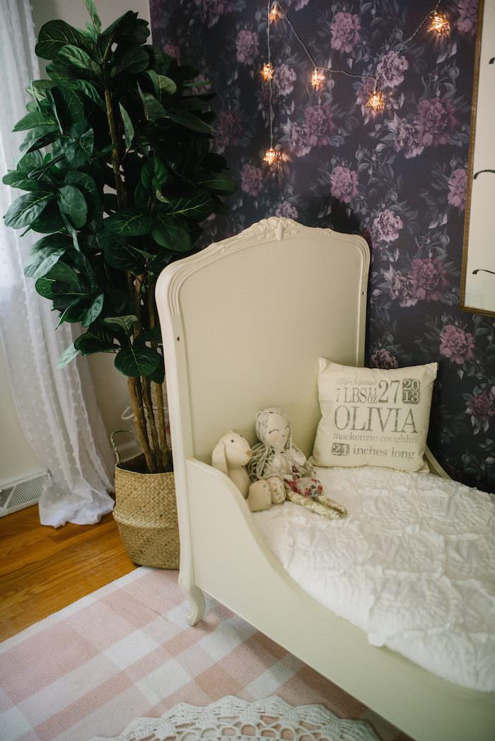 Lynzy & Co. showcases her daughter's toddler bedroom in this post featuring gorgeous floral wallpaper, a victorian crib converted into a bed and more!
