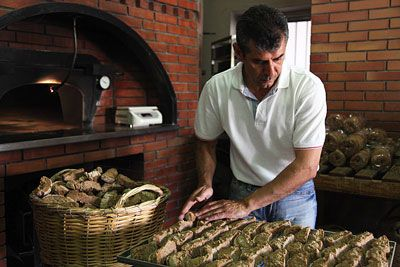 A baker making paximadia, or Cretan twice-baked barley rusks.