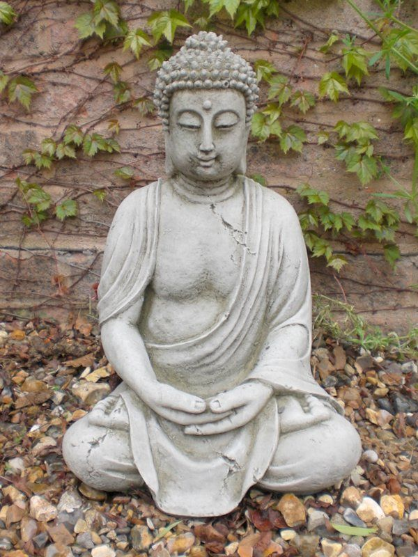 large stone buddha statues make the yard a place of wonder. Black Bedroom Furniture Sets. Home Design Ideas