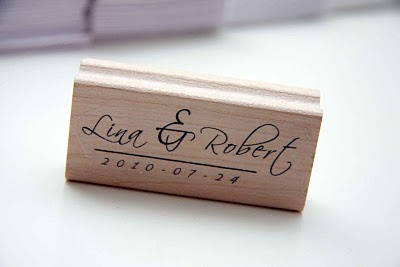We created our own rubber stamp that I embossed in silver on the front of our wedding invitations