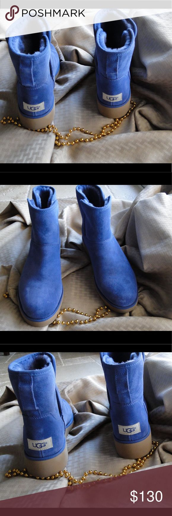 Brand new UGG classic Short II Blue Boot *Brand new, without box. *Plush Sheepskin *Cushion Support *Scotchgard tm * Pretreated 17mm Twinface *UGG pure Wool *Thermostatic *Treadlite *Size 9.5 *Color: blue UGG Shoes Winter & Rain Boots