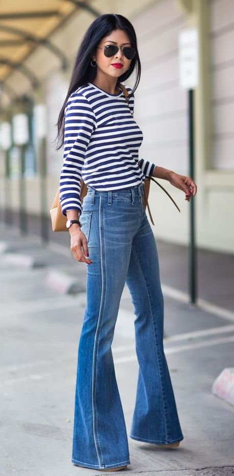 The bell-bottom jean is back in style, ladies! We love pairing these with our favorite platform wedges, tunics and floppy hats! How would you style these jeans?