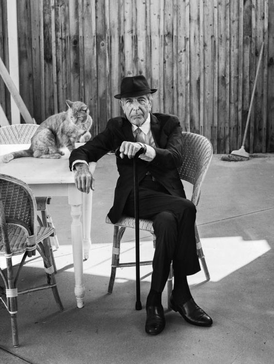 Leonard Cohen and a cat.