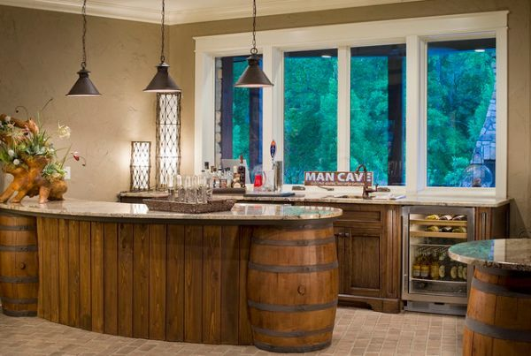 incorporate the barrels into your furniture's design. For example, take a look at this kitchen island. The barrels are part of the supporting base but they are incorporated in the design and the base has a wood construction with a texture and finish very similar to that used for the barrels.