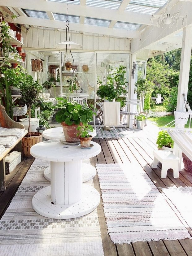 wooden cable spool table white painted terrace flower decoration
